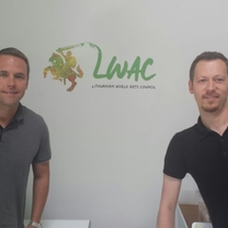 Our partner from USA - Vladas Krivickas with a founding member of LWAC - Marius Markevicius, posing in front of their brand new logo